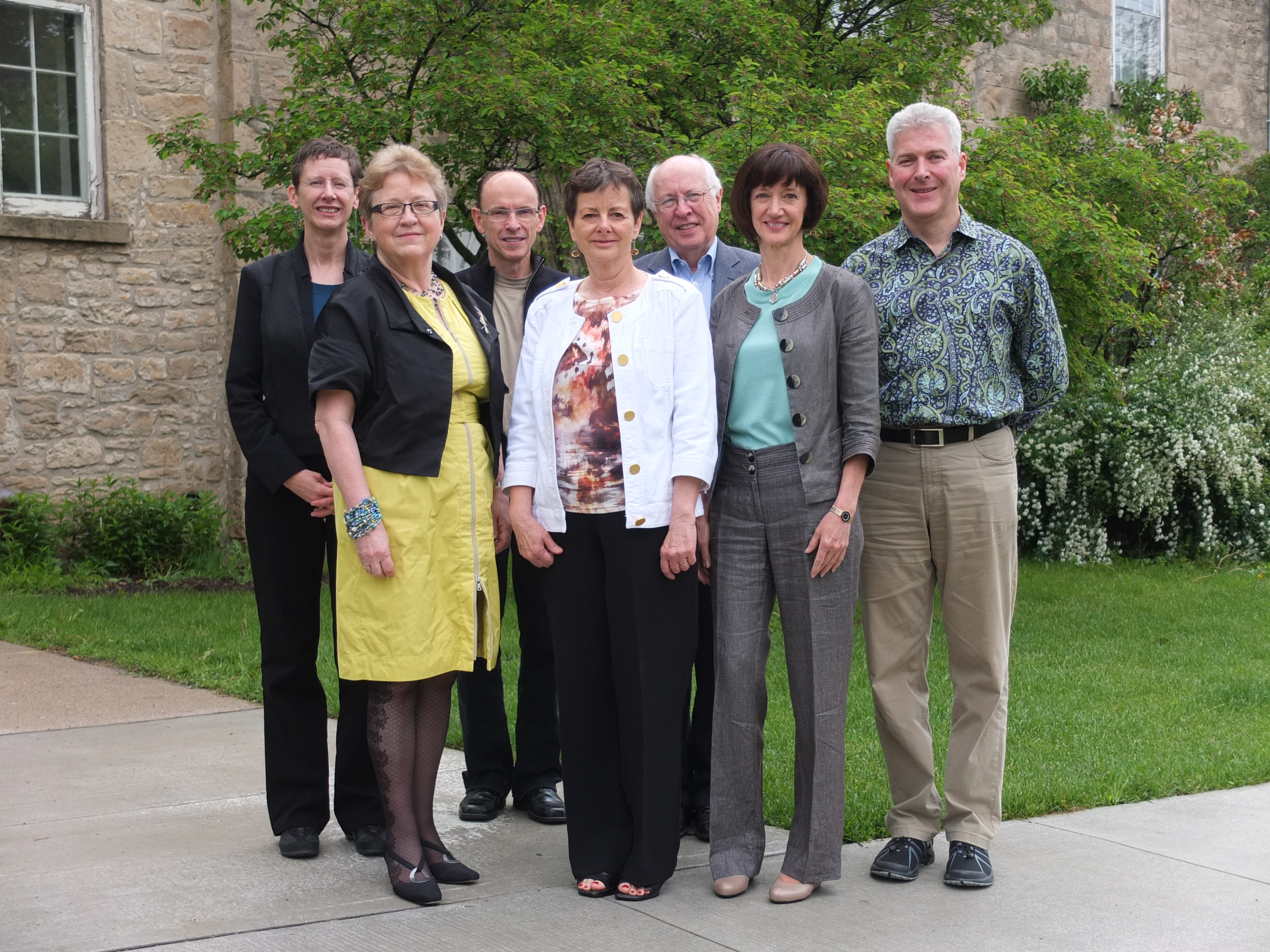 Musagetes Board and Founders standing in front of stone building
