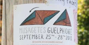 Musagetes Guelph Café Poster stapled with rusty nails to a neighbourhood telephone pole.