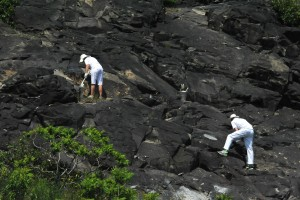 Two people cleaning rocks