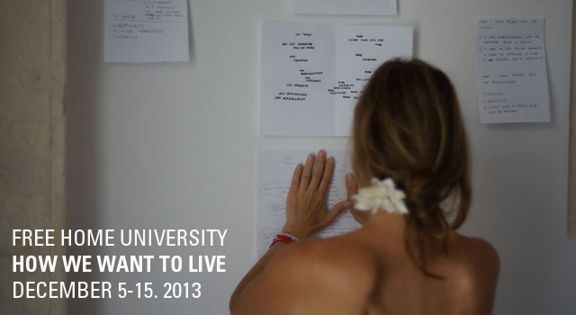 A woman with a white flower in her hair presses a piece of paper onto a whiteboard next to other writings